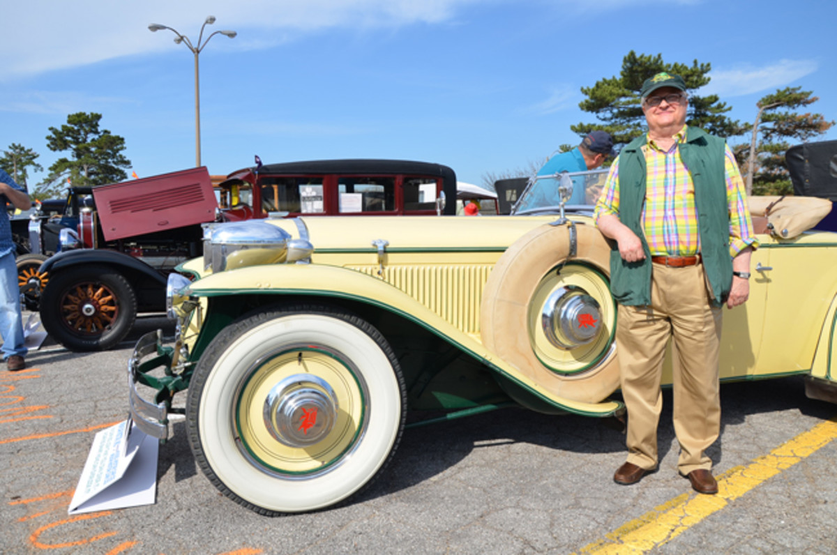 Fred Guyton at a recent concours event in St. Louis, posing beside his 1930 front-drive Ruxton.