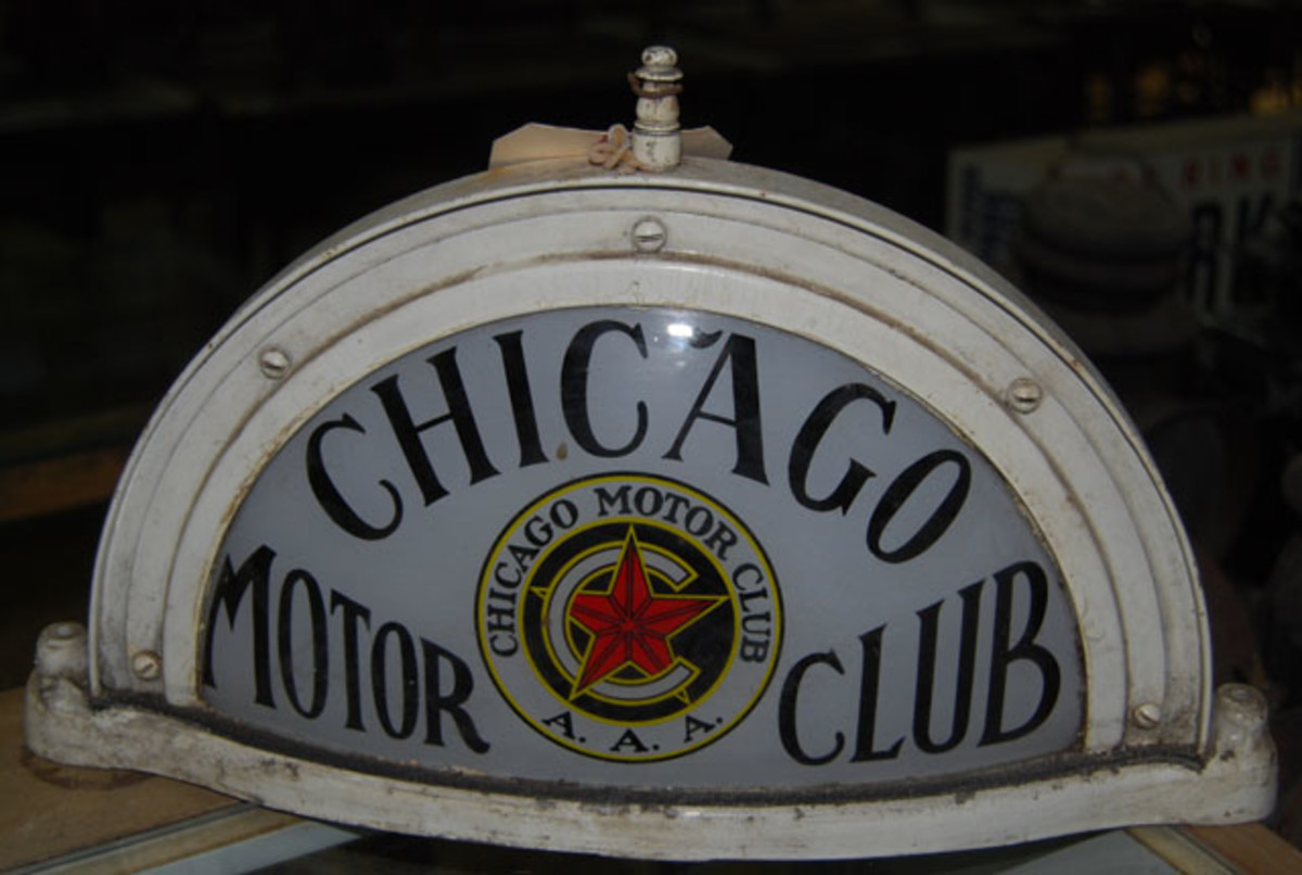 """Many of the collectible license plates and other items had connections to the """"Windy City."""" This sign was made for the Chicago Motor Club, which was a branch of the Automobile Association of America."""