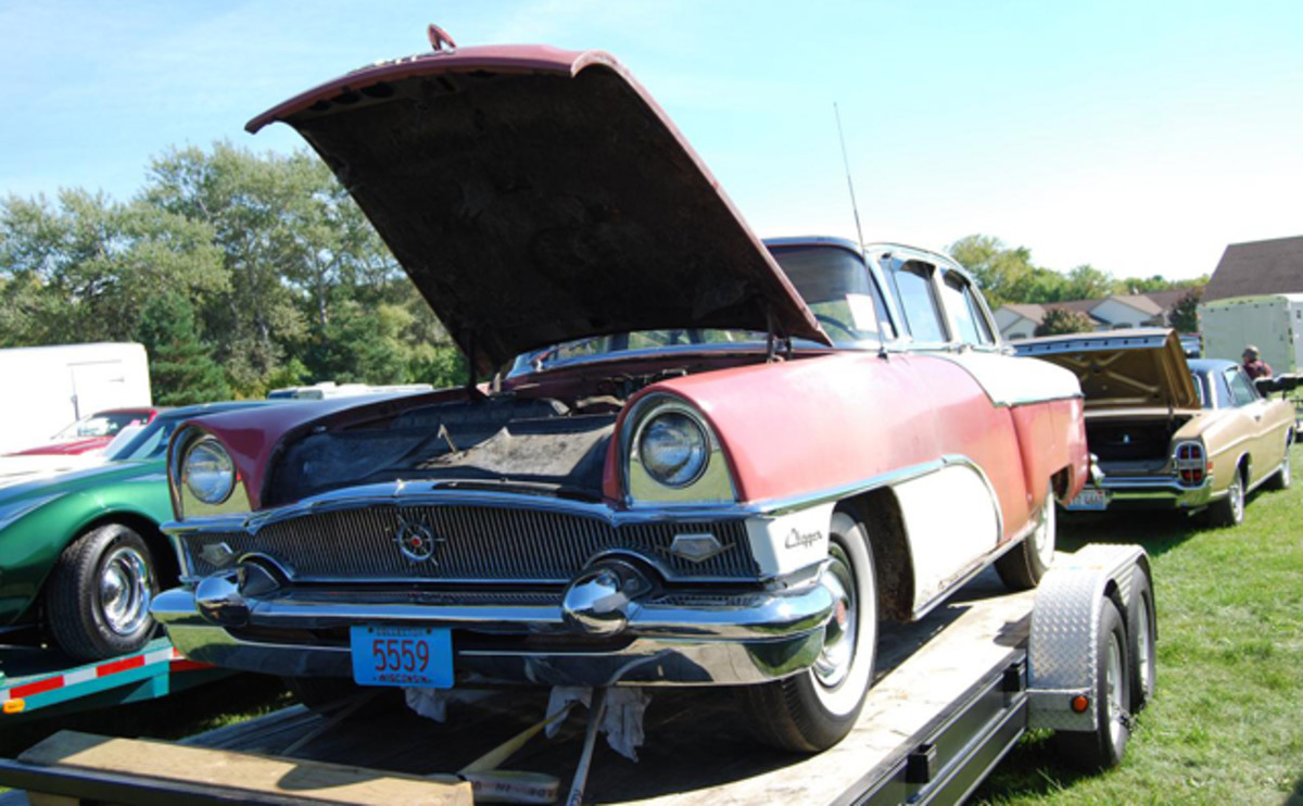 THIS '55 Packard Clipper sedan on a trailer at the Jefferson, Wisconsin Flea Market might look like a great restoration project, but do your homework before you jump into buying any old car.