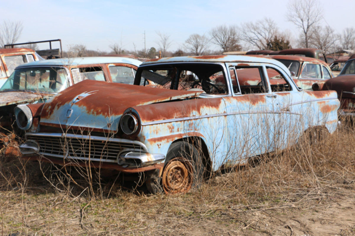 The driver-side trim on this 1956 Ford two-door Customline is in good condition. The passenger side trim is not good.