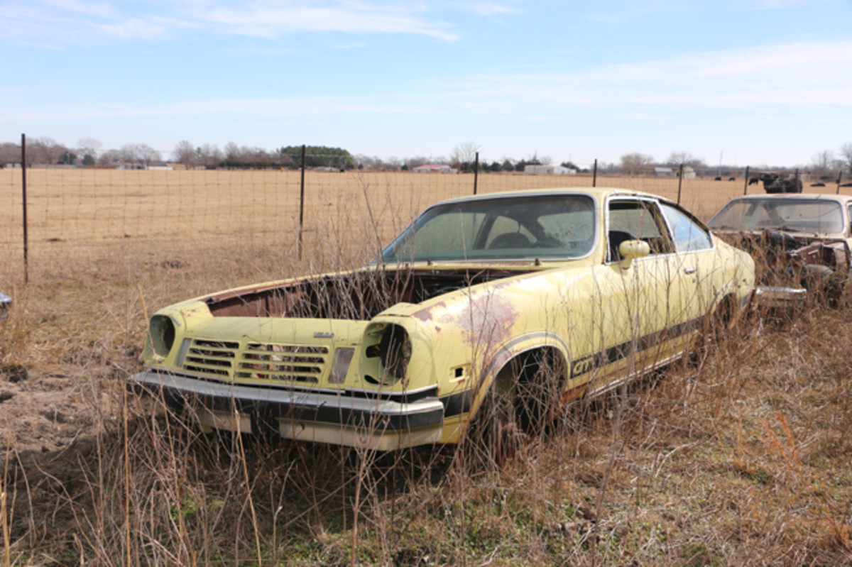There are about seven Chevrolet Vegas in the yard including this 1975 GT hatchback coupe.