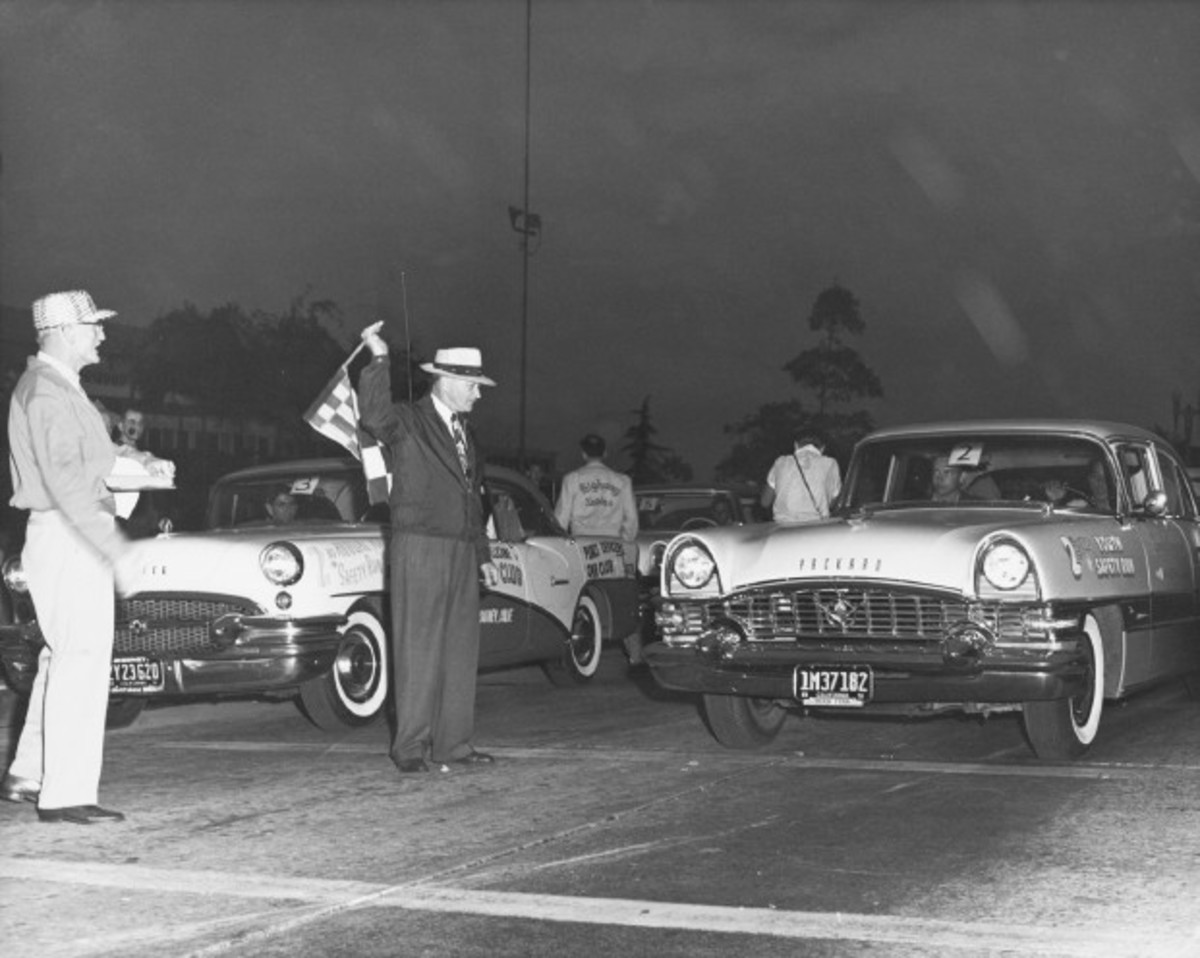 A 1955 Buick and Packard face off in the second Youth Safety Run in California.