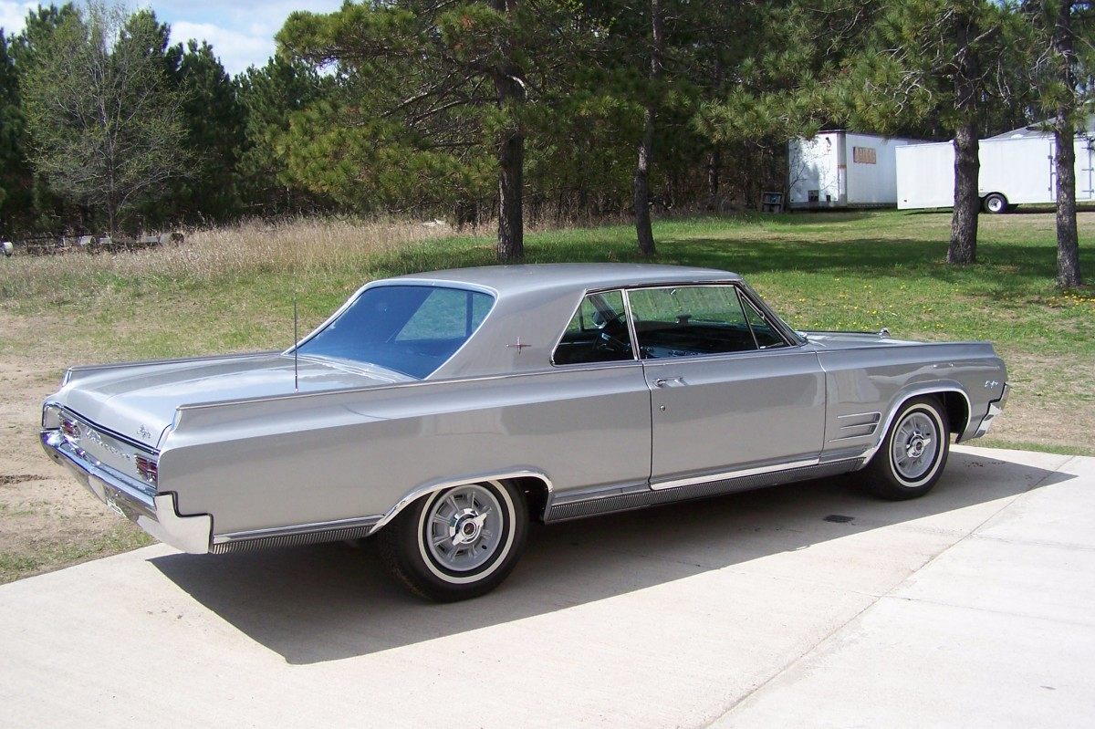 Rear view of the lithe 1964 Oldsmobile Starfire two-door hardtop.