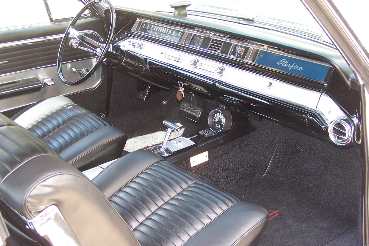 The bucket seat interior of the 1964 Oldsmobile Starfire. Compared to FoMoCo and Chrysler Corp, GM instrument panels generally weren't very inspiring during this era. However, the console and buckets make up for any lack of imagination in the dash.