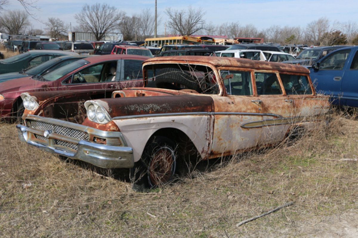 Most of the gold ribbed anodized trim is straight and serviceable on this 1958 Ford Country Sedan station wagon. The curved back glass is in good condition.