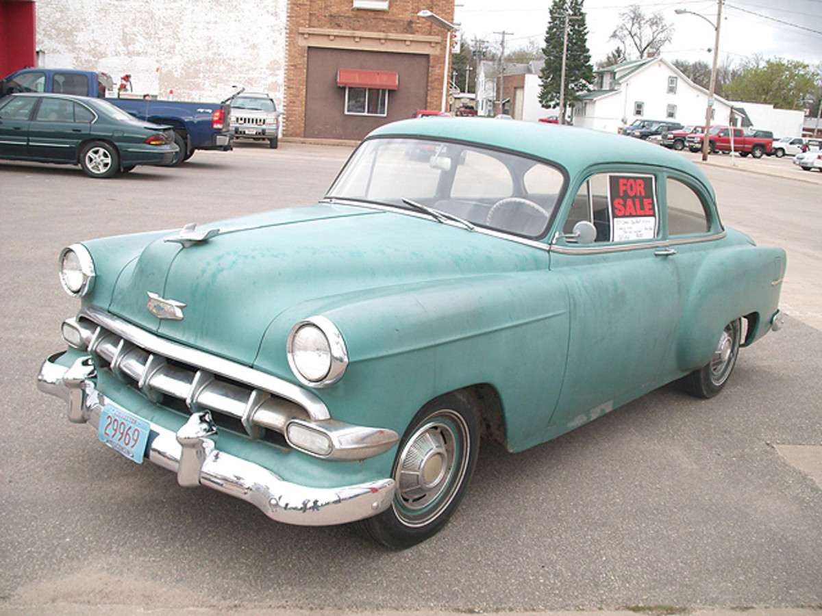 This '54 Chevy One-Fifty two-door sedan had a rebuilt six-cylinder motor and a $6,400 asking price. Do you think it was a realistic price?