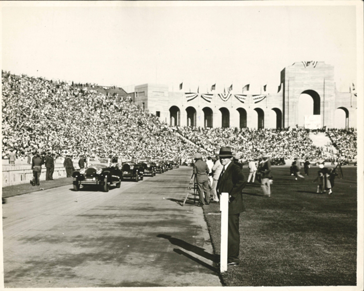"This original picture carries the hand-written caption, ""Lindbergh's Packardized parade of 42 cars circles track on arrival in Los Angeles Coliseum, Sept. 21, 1927."" The photo was sent by Earle C. Anthony to the Packard head office for national publication."