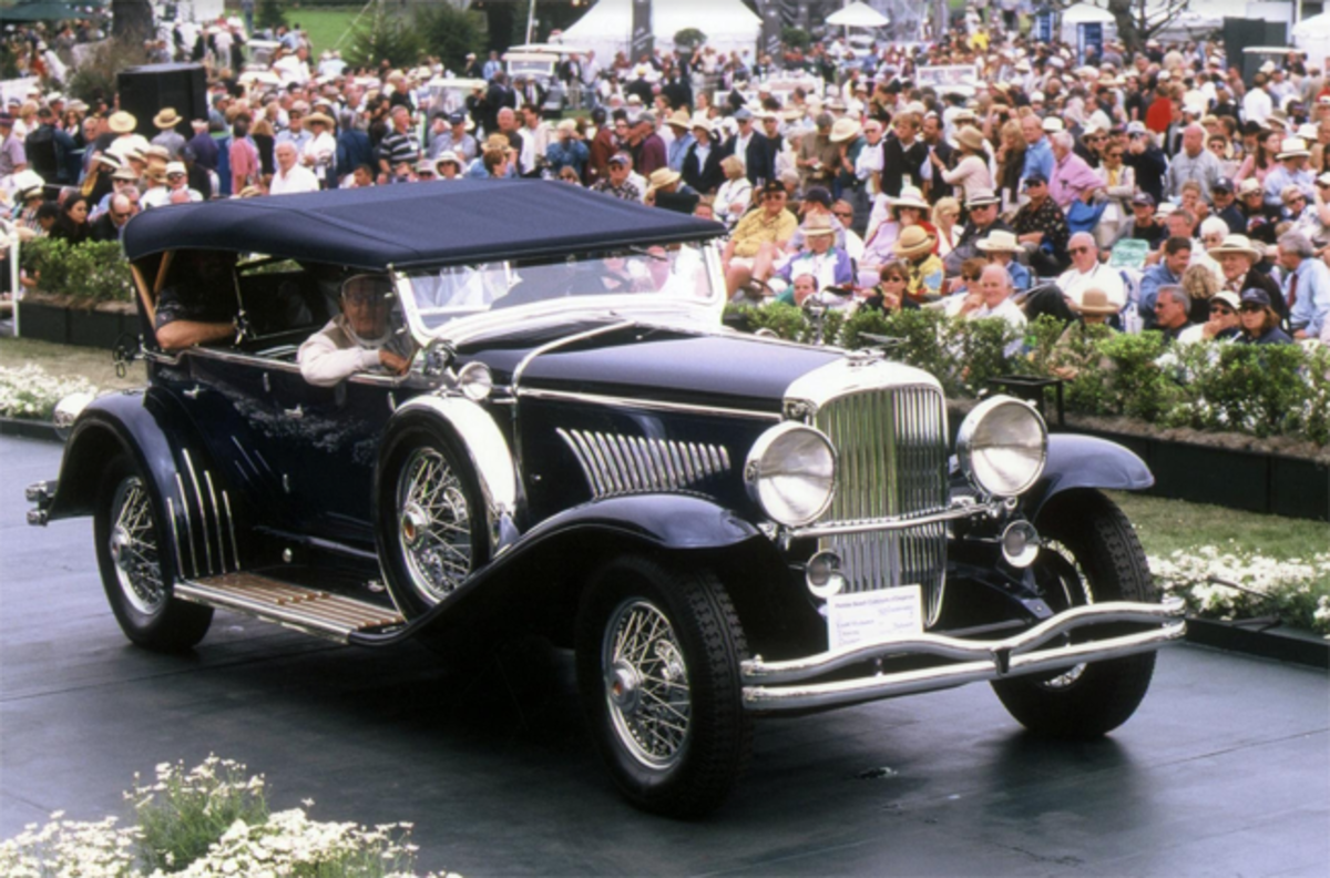 Roger Willbanks crosses the awards ramp with his 1929 Duesenberg J Derham Dual Cowl Phaeton at the 2000 Pebble Beach Concours d'Elegance.