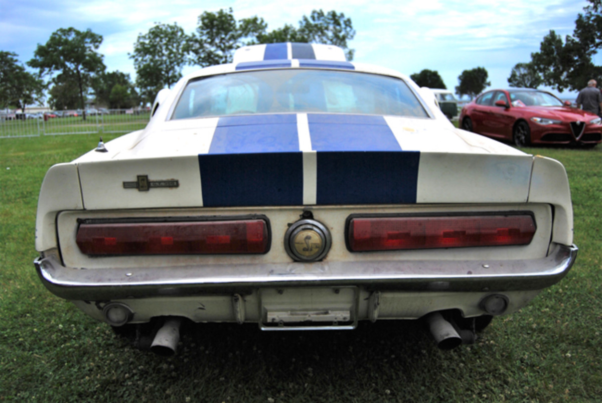 Years of storage and neglect have given the GT350 the patina it proudly wears. Note the Shelby's use of the '67 Mercury Cougar tail lights which were part of they Shelby package.