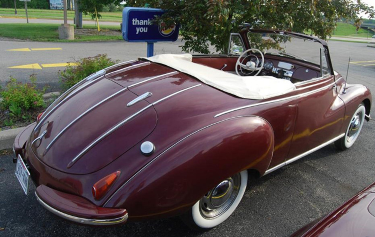 A streamlined look with chrome speed bars characterizes the rear end.