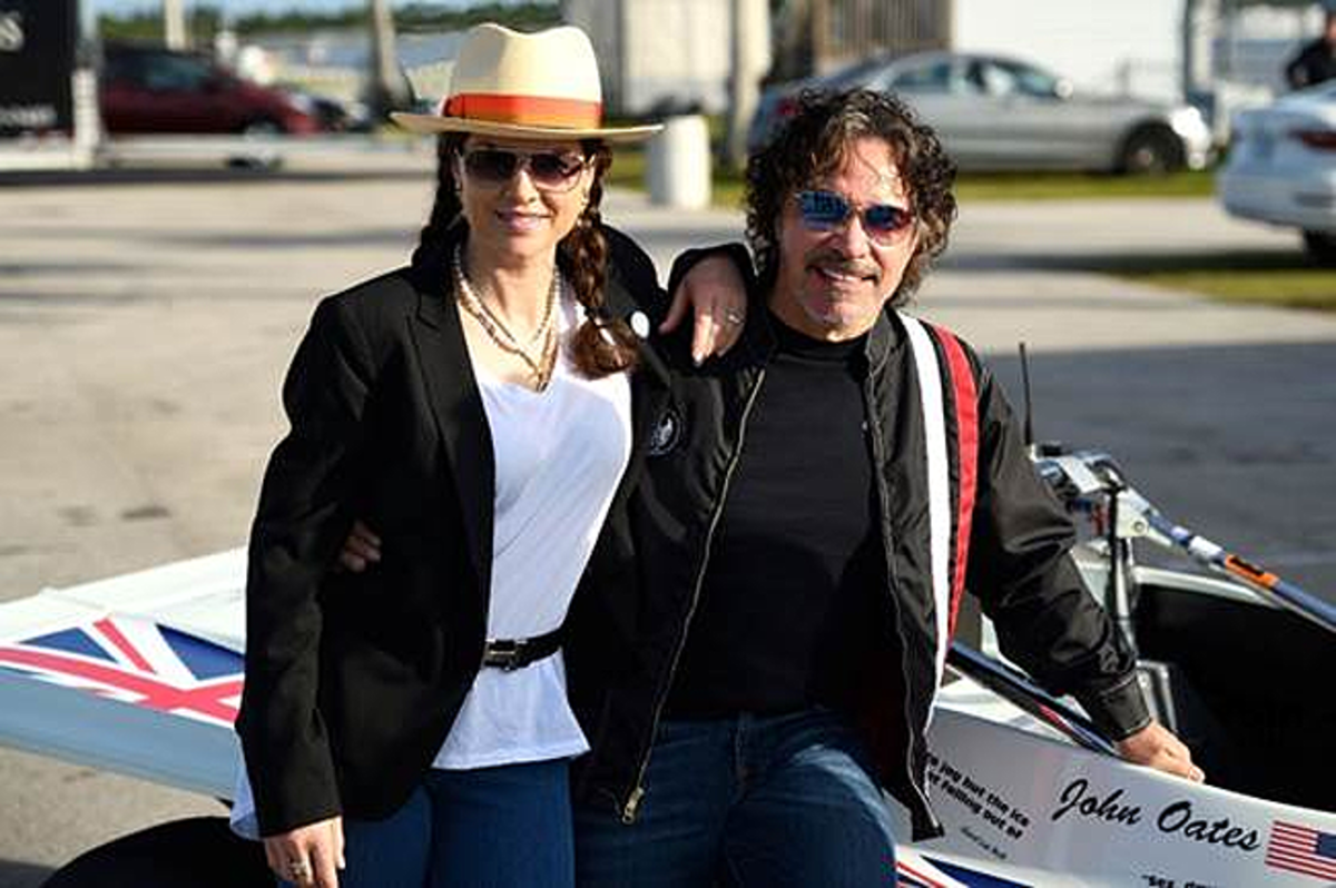 Rock-and-Roll Hall of Famer and car enthusiast John Oates and his wife, Aimee, posing with the 1984 Tiga SC84 Sports 2000 (Credit – John Singer 2020 Courtesy of RM Sotheby's)