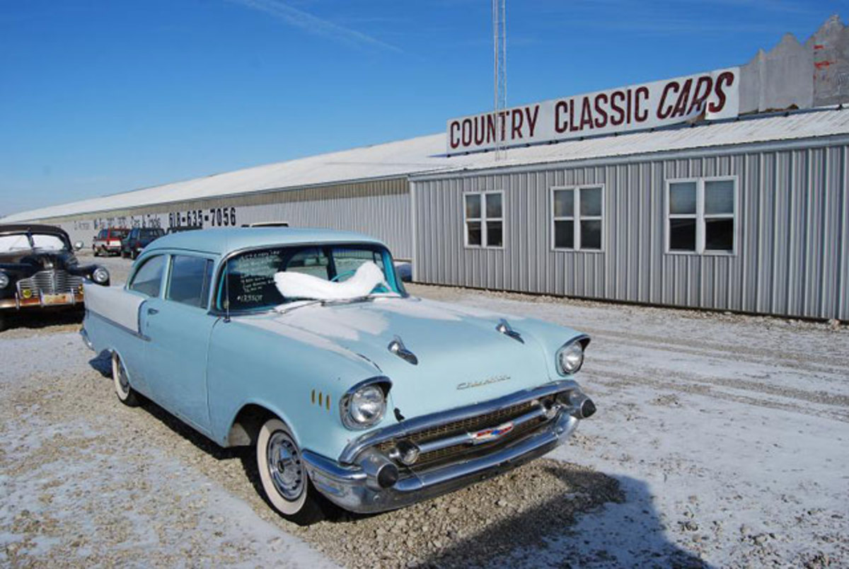 """The """"outside"""" cars like this '57 Chevy lure highway travelers in."""