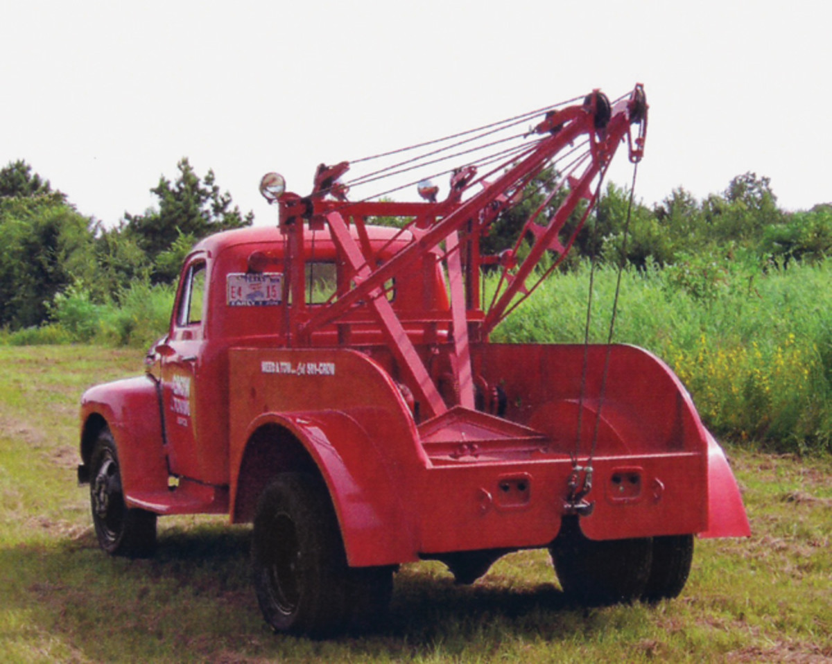 "Rear view shows the ""business end"" of the restored '48 Ford F-4 wrecker. The twin-boom Holmes 490C was a very practical unit for businesses such as Newman Brothers Ford. An experienced operator could do a lot with a 490C."