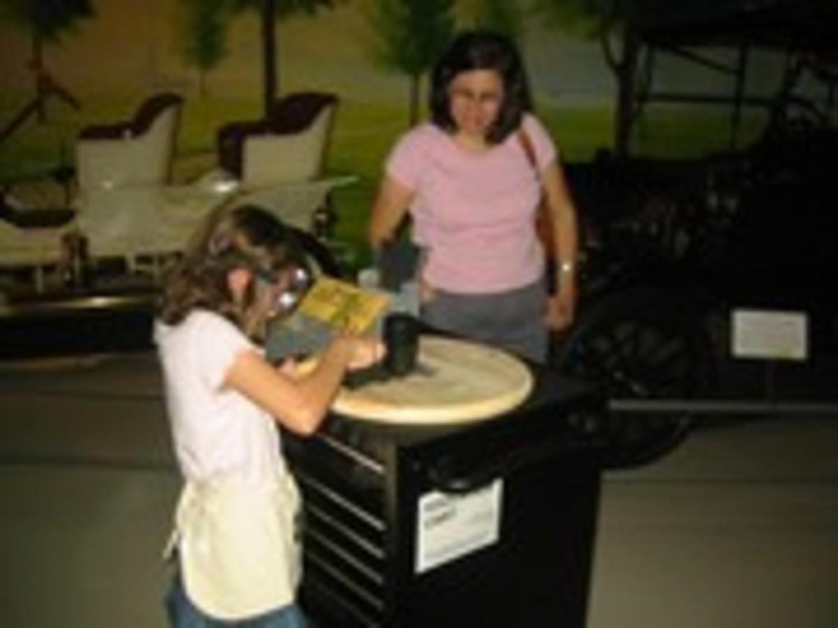 Girl at Education Cart.jpg