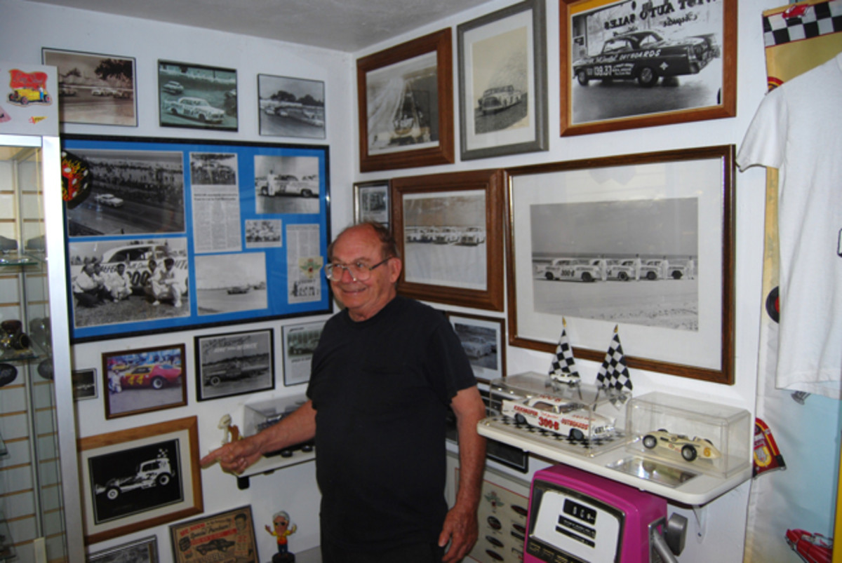 Mike Martin points to a racing photo in the Chrysler 300 room at Classics Plus Ltd. in North Fond du Lac in May of 2012.