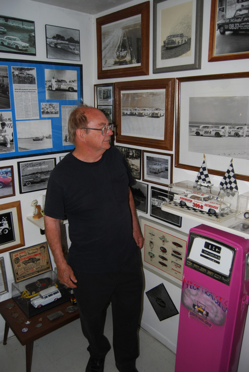 Mike Martin looks at vintage Chrysler 300 photos and models on display at Classics Plus Ltd. in North Fond du Lac.