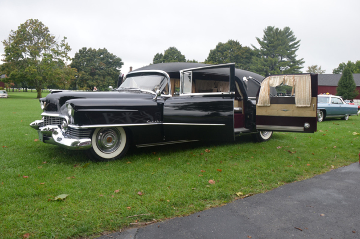 1954 Eureka Cadillac side-load funeral coach in the display-only area of the concours.