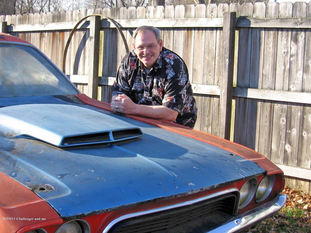 Bob Evans stands by his '72 Challenger – a 340, four-speed. There are only minor rust spots on the rear quarter panels, but he said the big problem is the roof, which he has plans to replace.