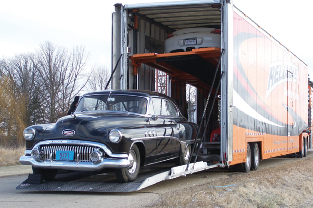 "Carl Wallin for Reliable Carriers, Inc. recently loaded the barn-find 1951 Buick Special Riviera coupe previously featured in Old Cars Weekly. The car was leaving John Gunnell's ""Gunner's Great Garage"" in Manawa, Wis., for the Sacramento, Calif., garage of the car's next (and only second) owner."