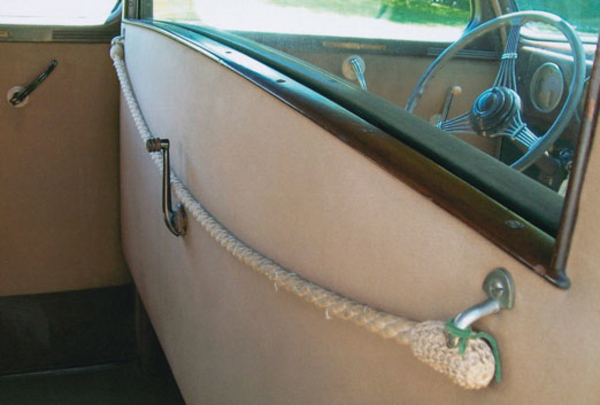 A division trimmed with wood and a nautical-style braided rope separates the driver's compartment from the passenger compartment.