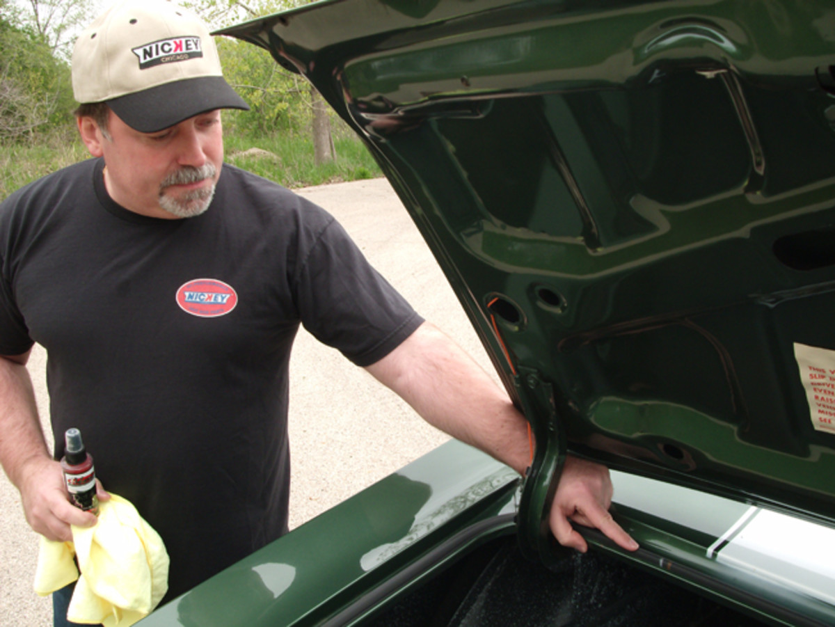 Here, Steve Bimbi, of Nickey Chicago, points to markings on the original weatherstrip on the trunk opening. The car's decklid also has a stamping on it that verifies the body style of the car.