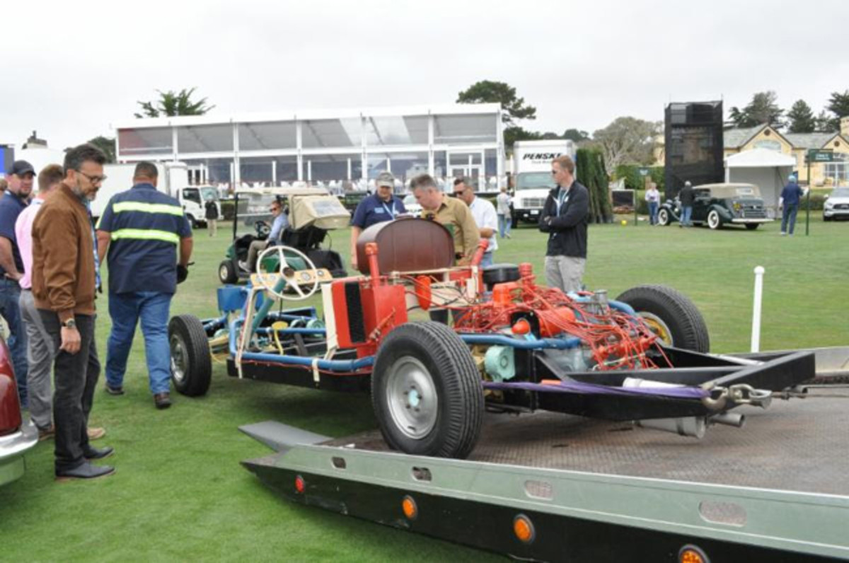 Mark Lieberman oversees the unloading of the factory test chassis at Pebble Beach.Photo - Bill Rothermel