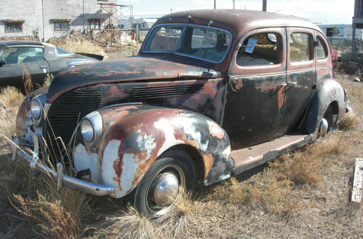 In almost survivor-class condition, this 1938 Ford Fordor is complete down to its hubcaps and accessory bumper guards.
