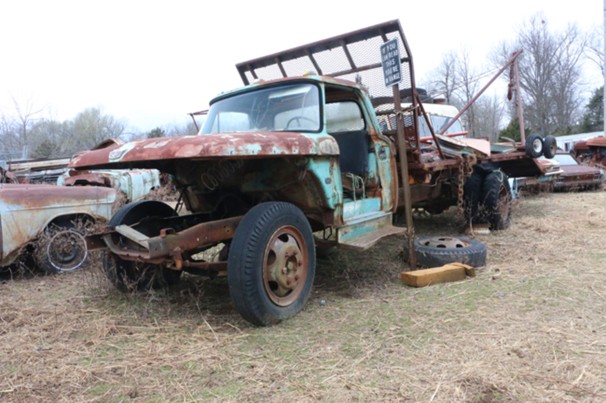 A parted-out 1966 F600 Ford boom truck brought many vehicles to the yard, and has also taken some of them to the recycler.