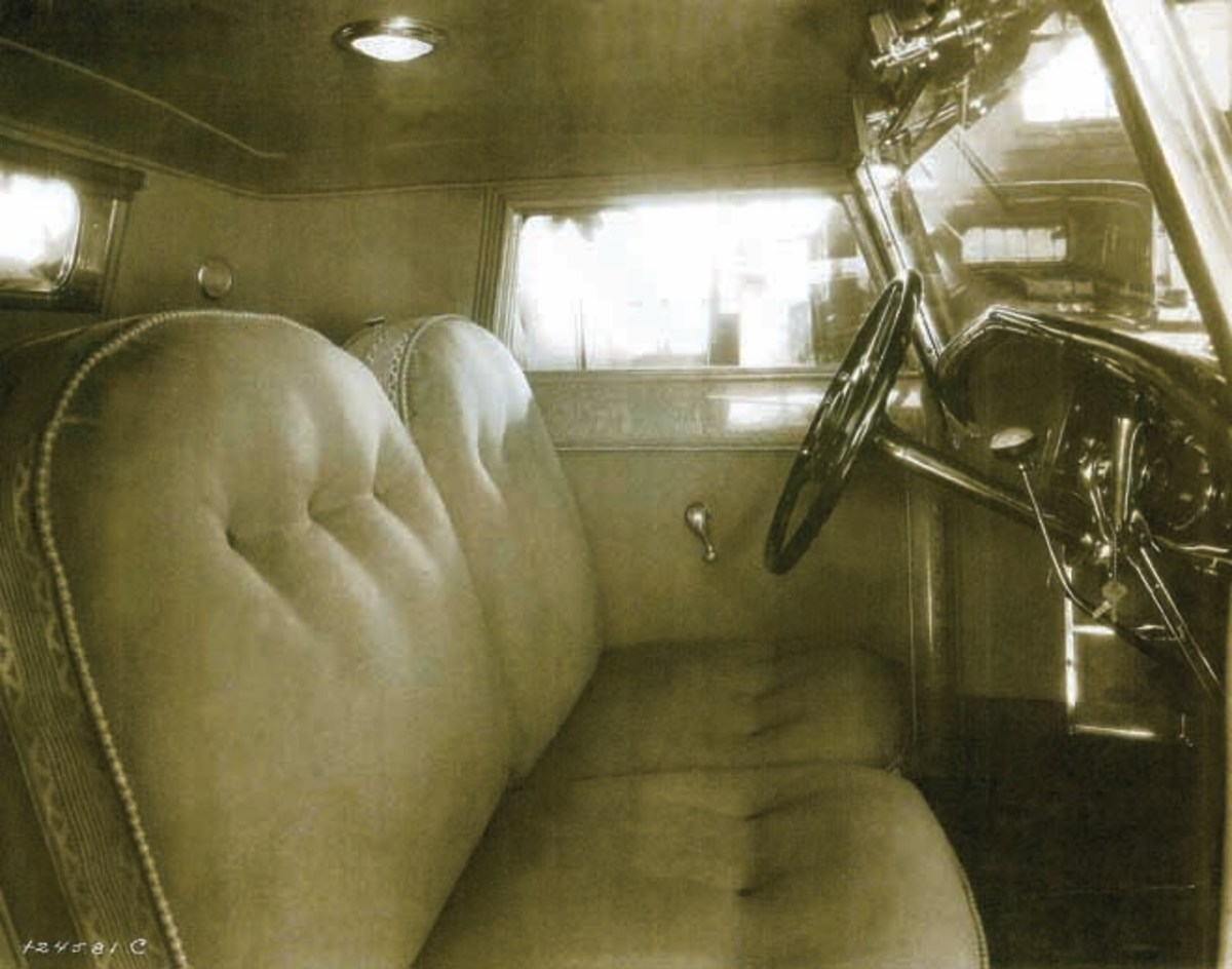 A view of the car's original interior showing the lacewood trim and the adjustable seats. Note the windshield wiper goes through the glass of the windshield. (Randy Ema collection)