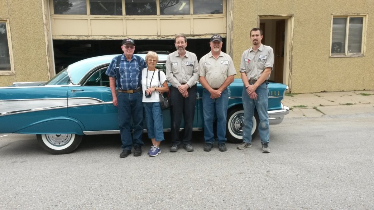 Gerald and Betty Hixson (left) with the team at Petersen Body Shop, which restored the car.