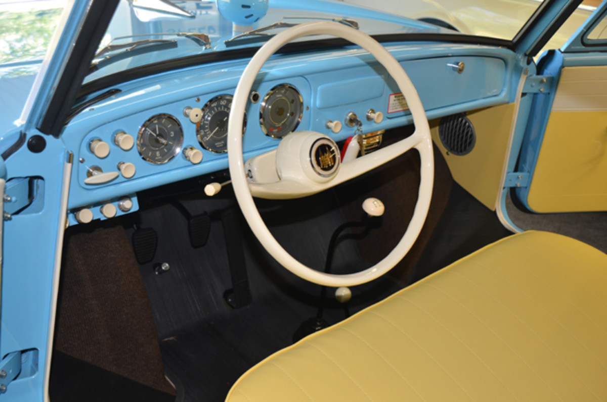 Lagoon Blue Amphicars were fitted with yellow-and-white upholstery. In addition to standard automotive gauges and switches, the Amphicar has switches for the boating lamps and the bilge pump.