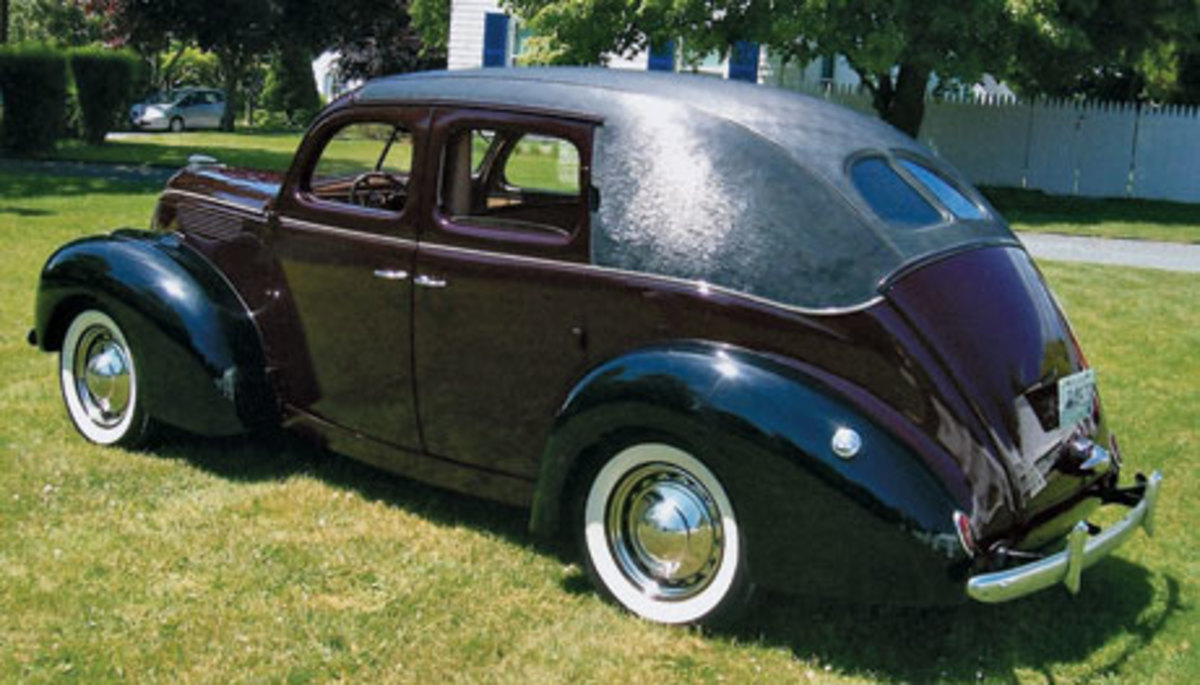A roof covering that blanks out the rear side windows caps off the Vanderbilt 1938 Ford and adds to its elegance. The car lacks running boards and wears the fully plated wheel covers.