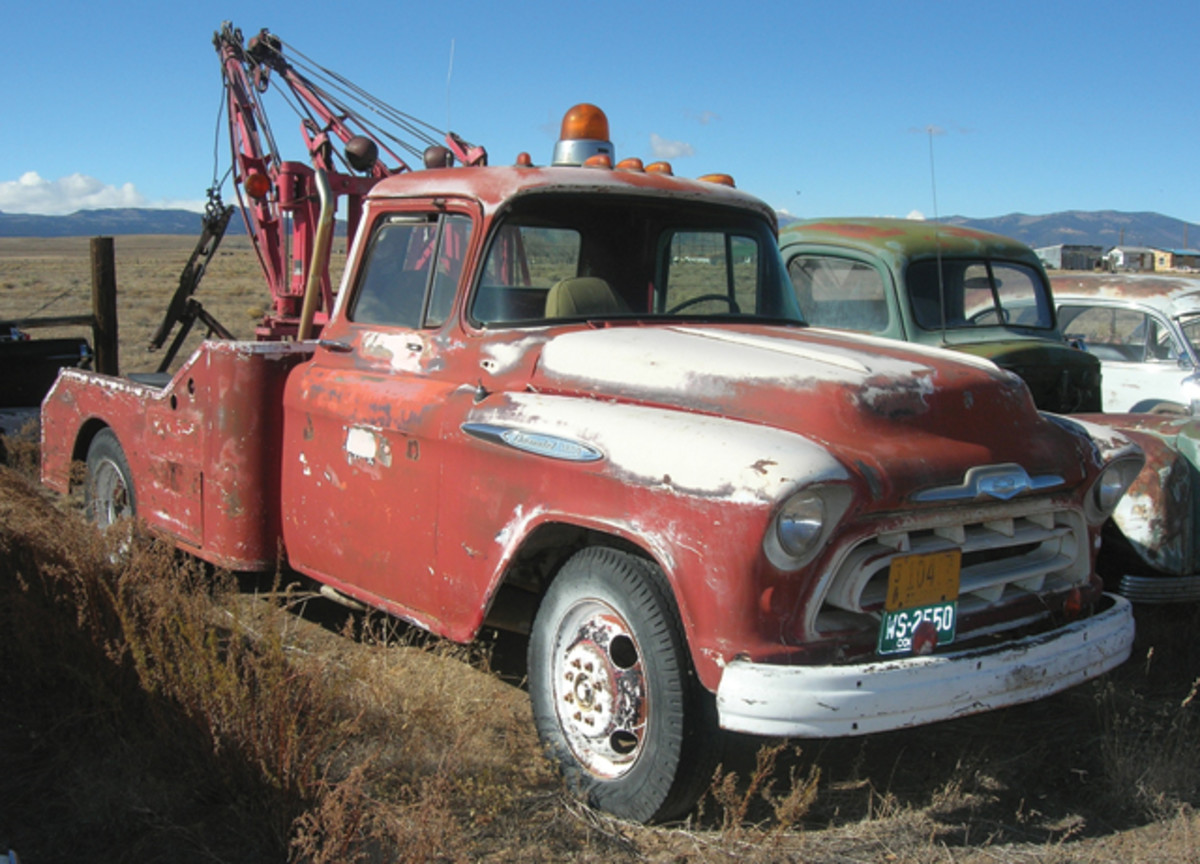 Equipped with a fully functional boom, this 1957 Chevrolet wrecker appears as if it could restart towing disabled vehicles on a moment's notice.