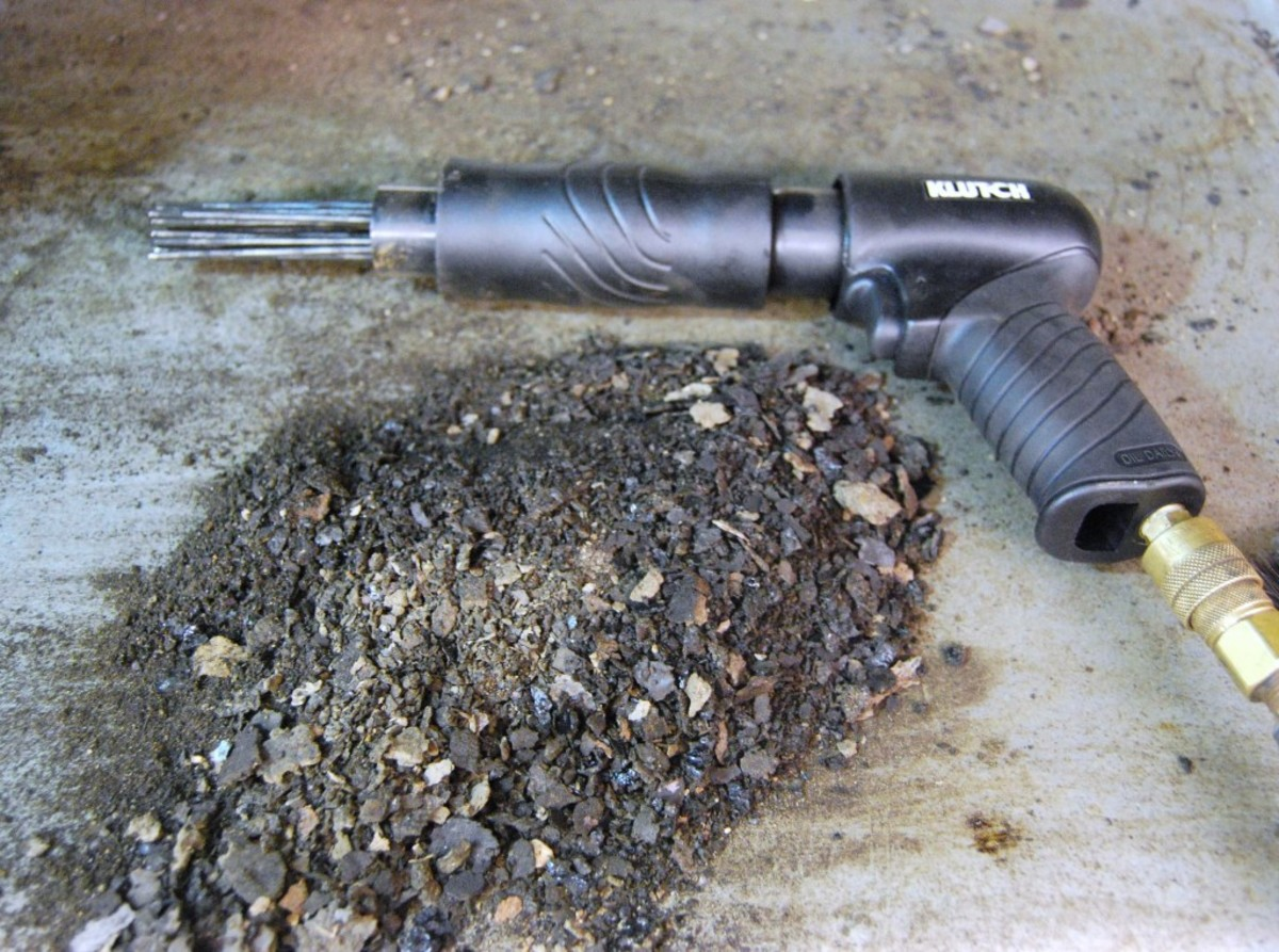 Here is an example of the amount of debris that the needle scaler removed from just half of one wheel well of a car.