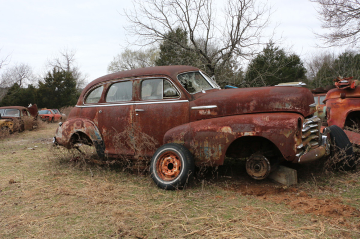 A 1948 Chevy four-door sedan is strictly a parts car, and has had many parts already taken off of it.