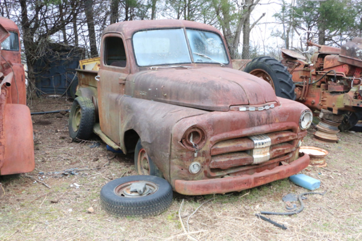 Another vehicle bought at an auction is this Dodge pickup. It was running when it was put in the yard, but the engine has since been removed.