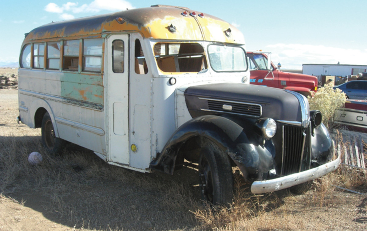"Ernest and Sons Auto Wrecking contains quite a few vintage buses in its inventory. This 1941 Ford ""shorty"" example, with some restoration, would make a fun driver to ferry friends to local car shows."