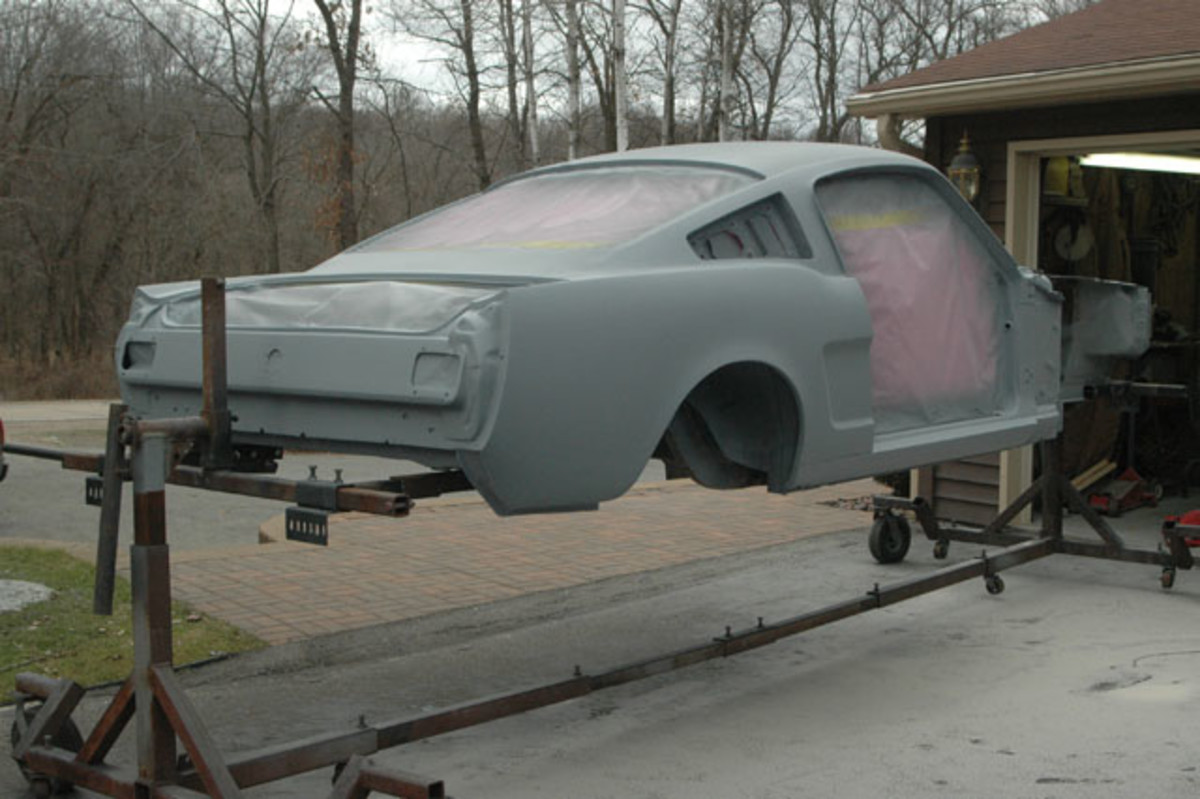 The body work is finished on the top side of this 1965 Mustang fastback, but the floors have only been butt welded and need finish work to be in show condition.