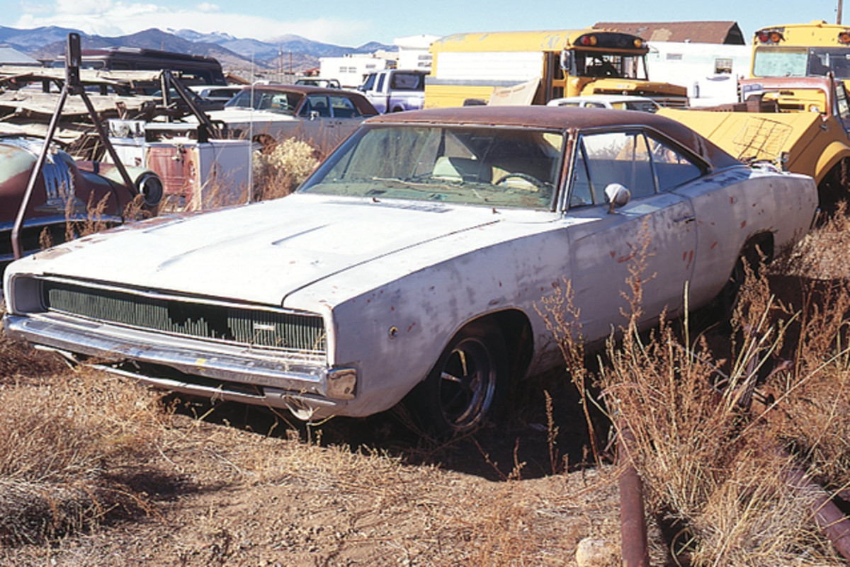Muscle cars have all but disappeared from salvage yards, so it was a treat to find this 1968 Dodge Charger squirreled away among buses, trucks and various machinery. The Charger is complete, but in need of restoration.