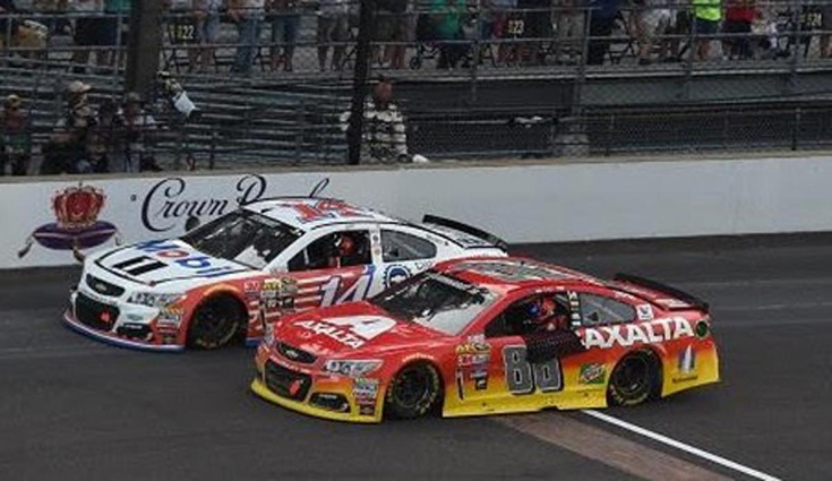 Stewart (white car) and Gordon (red car)
