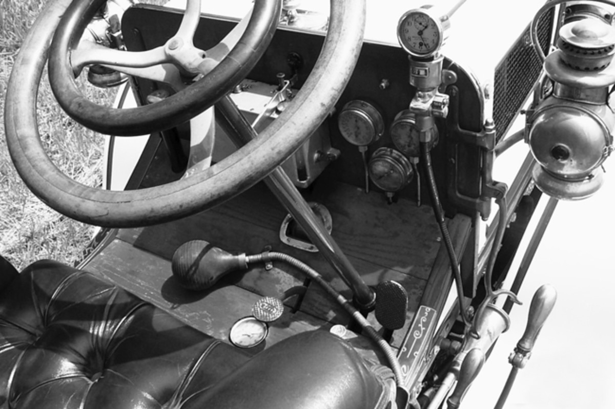 The cockpit of the 1907 White has no shortage of wood, brass and gauges.