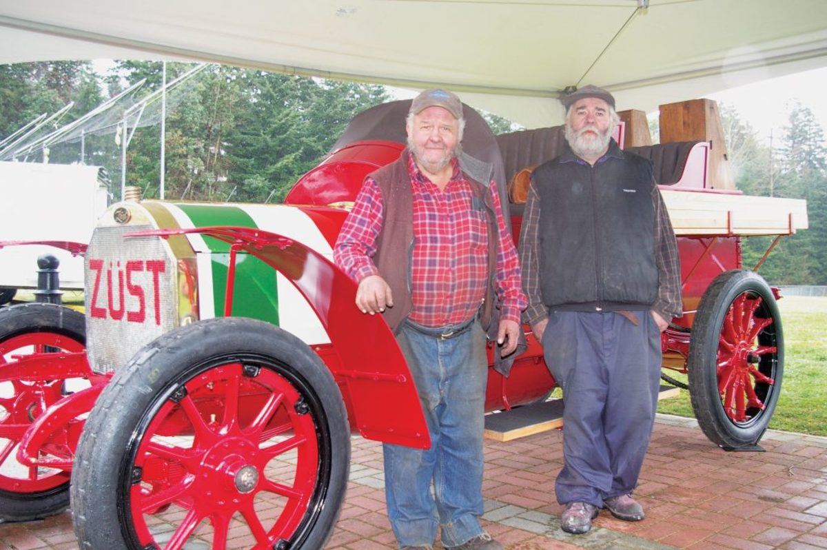 Brothers Harry and Jimmy Blackstaff, two restorers of pre-1915 automobiles, stand with the Zust that they restored.