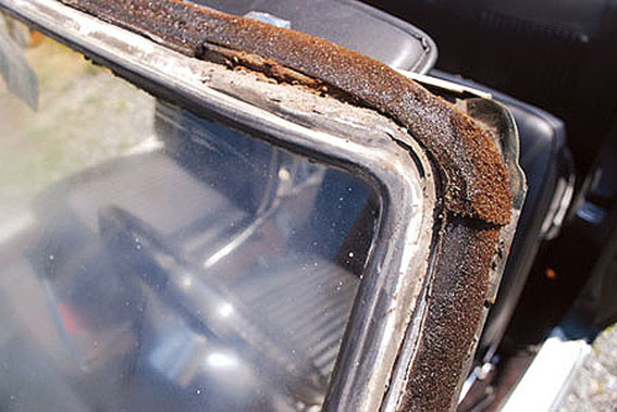 After pulling the trim we all agreed that it looked like the windshield area hadnever been taken apart before. It was in very good condition for the northeast,with only minor rust in the driver's side upper corner. Next, the interiorwindshield trim, rear view and visors were removed.