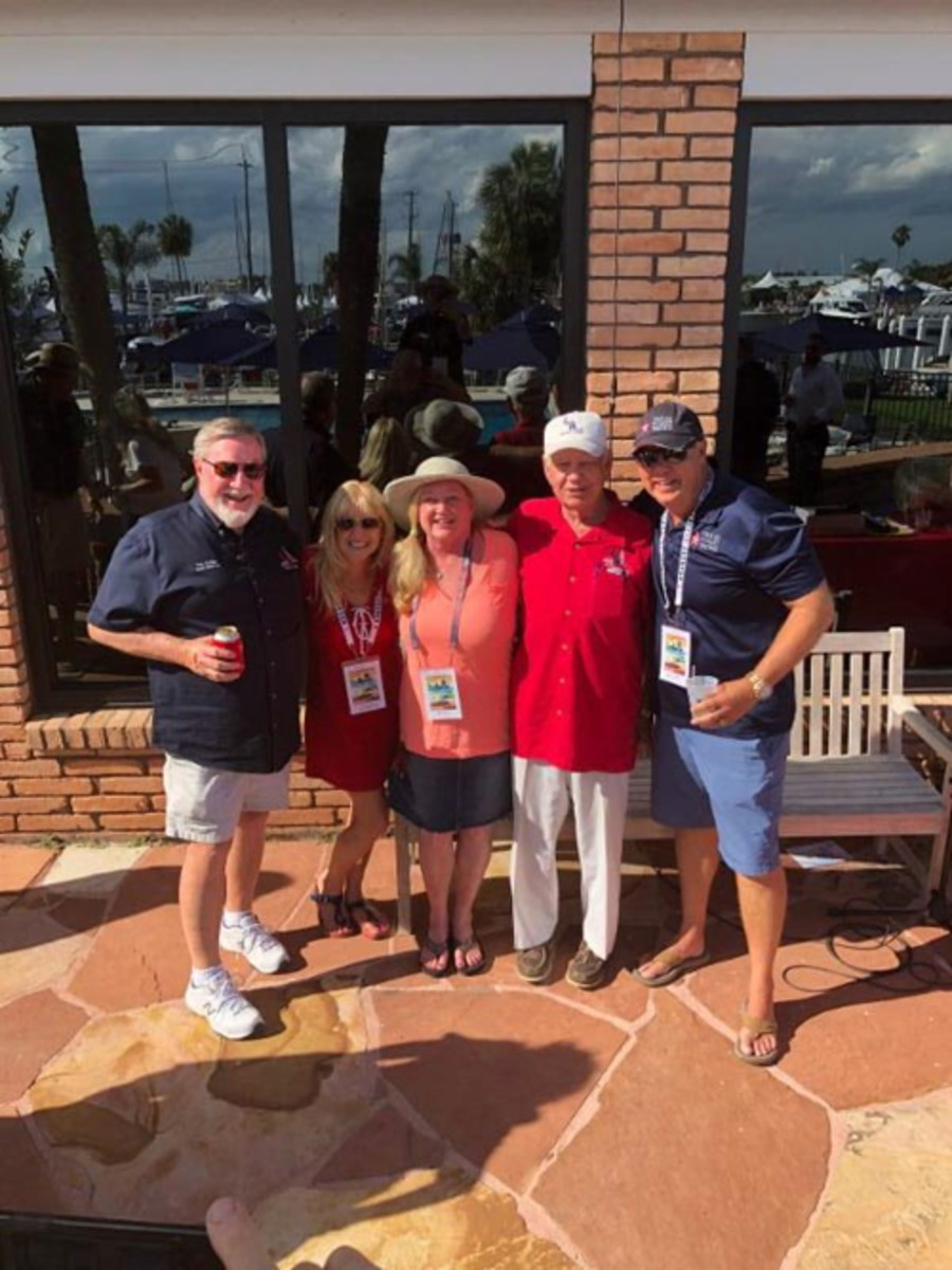 Lori Hunt (middle) winner of the boat, pictured here with Bob Fuller, Tom Collier, Jeff Johnson and Cheryl Baron, (with Texas Coast Yachts), who donated the boat used in the event raffle.