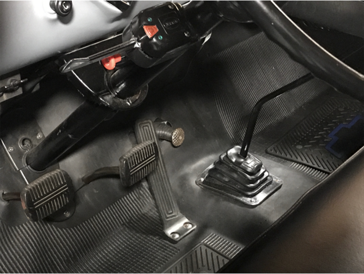 Between the accelerator and gear shift, is a starter pedal.