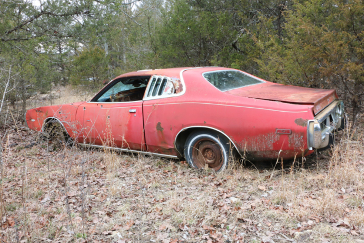 Someone has used this '73 Dodge Charger for target practice. The are several bullet holes in the driver's door and front fender. The hood is off, but is nearby the car and also loaded with bullet holes. The engine is gone, but it was equipped with a 400-cid V-8 engine with a 2-barrel carburetor. The car has a factory sunroof, which set the original buyer back $286.