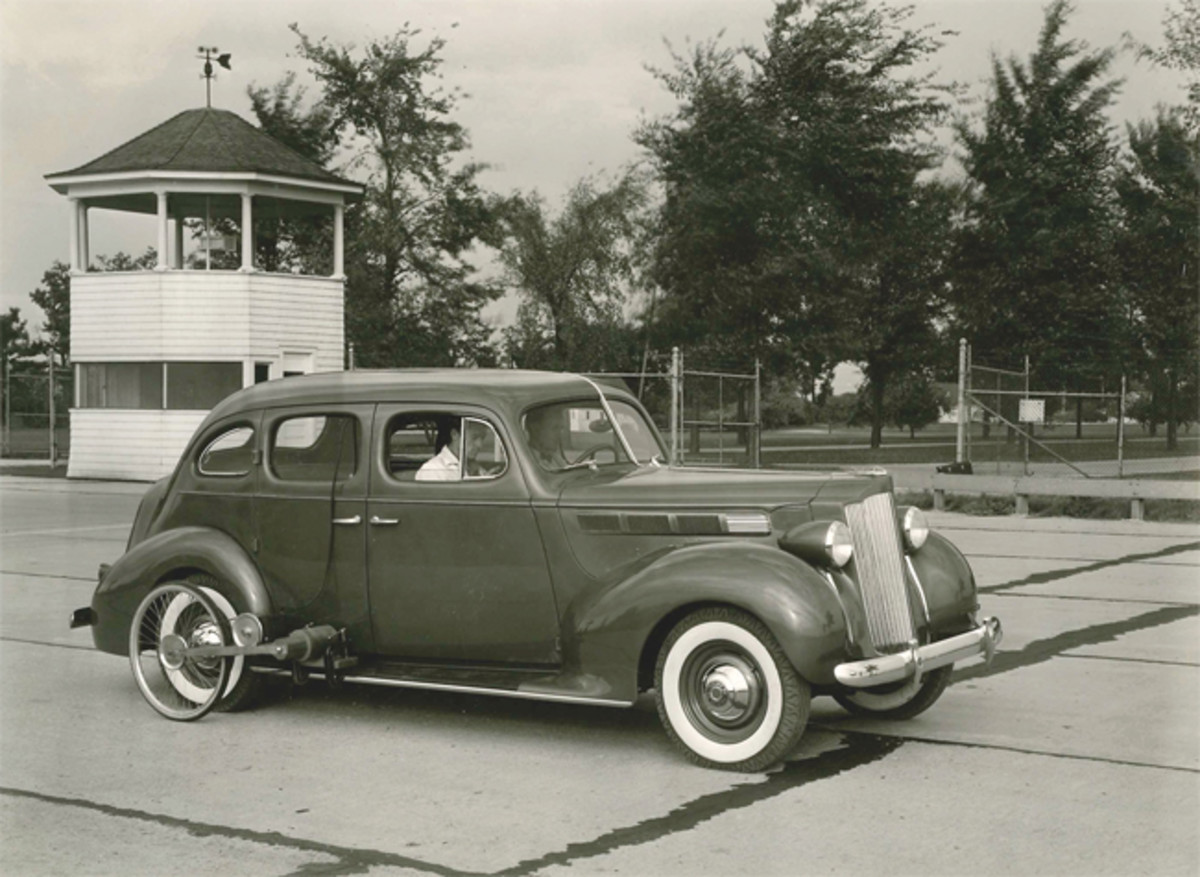 A 1938 Packard Six runs the Proving Grounds in tests. At times cars (selected at random off the assembly line) were literally destroyed in tests to uphold the quality goals of the venerated car maker.