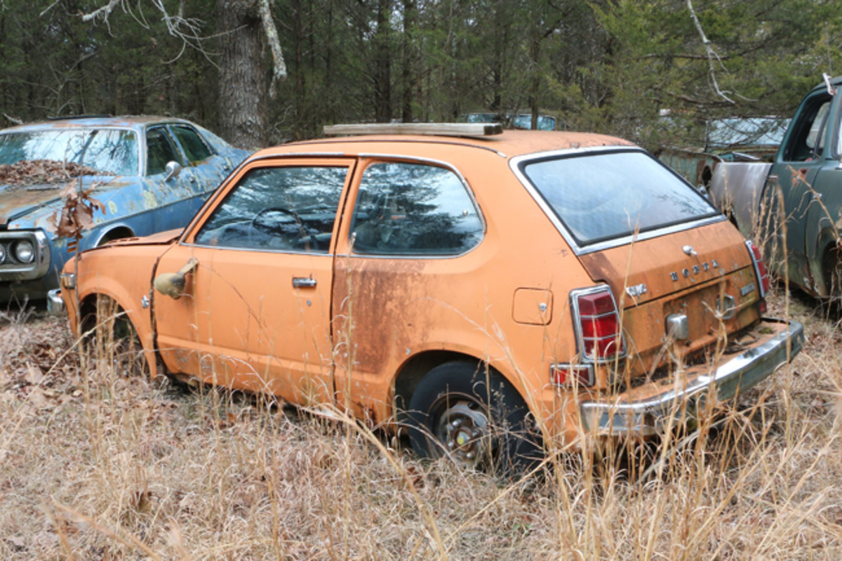 The engine block is still under the hood of this hard-to-find mid-1970s Honda Civic. It has body rust issues, but does have trim parts available.