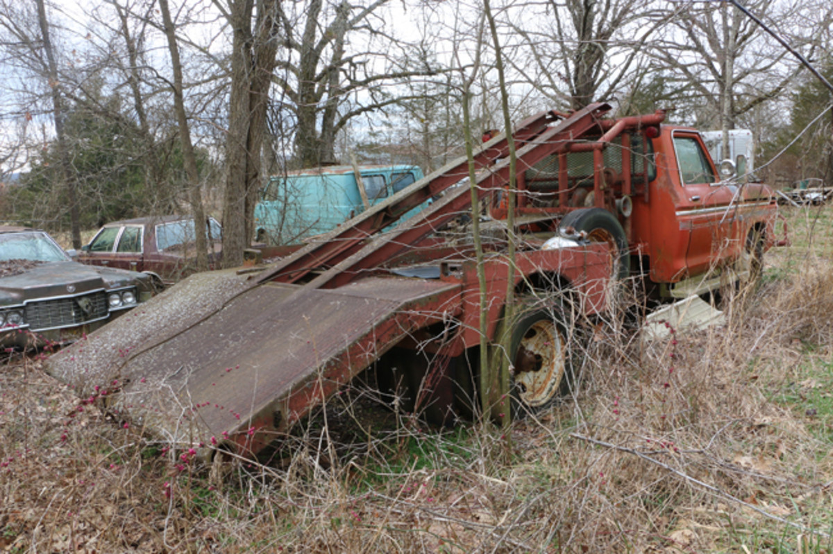 Many times, Jackson found that the cars he went to pick up were already stripped of their running gear, so he built this one-of-a-kind car hauler to hoist a vehicle on the back and haul it to the yard. The 1975 Ford truck body is mounted on a 1960 GMC frame and is powered by a Chevy engine.