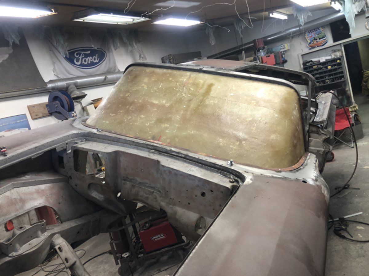 "To my amazement, the mock windshield fit perfectly! In this picture you can see the filler panel between the cowl and ""windshield."" Now I just need to build a crate for the plaster mold and ship it off to Canada and wait for the new glass to arrive."